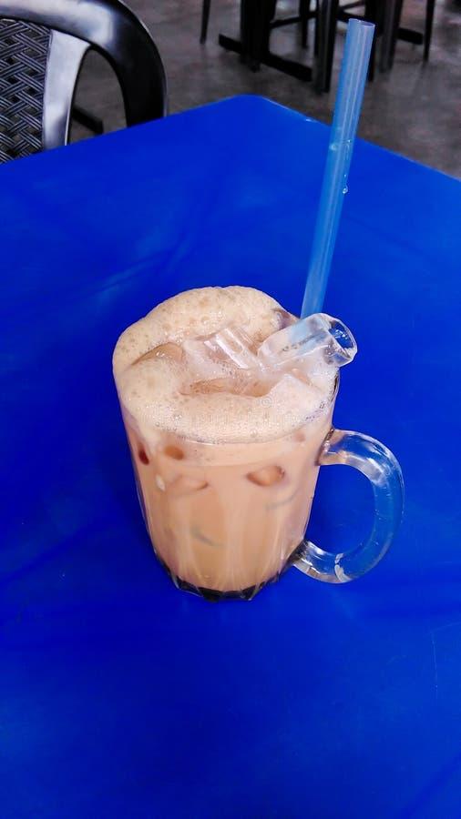 A milk tea ice. A tea milk iced serve on glass. Teh ais called by Malaysian royalty free stock photos
