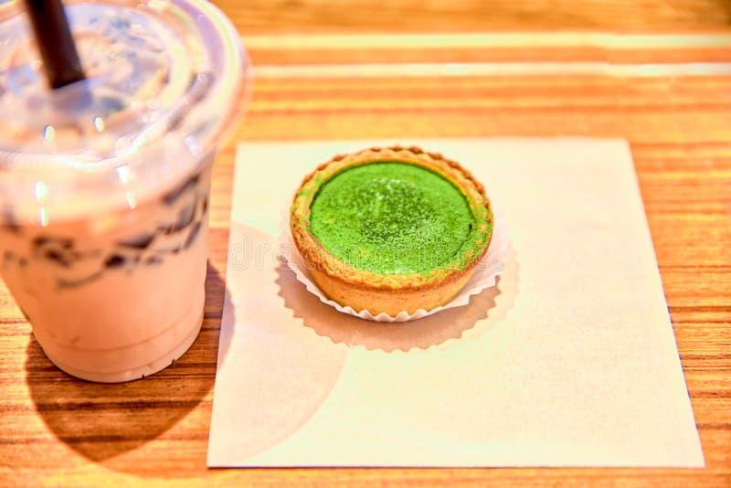 Milk tea and macha cheesecake stock photography