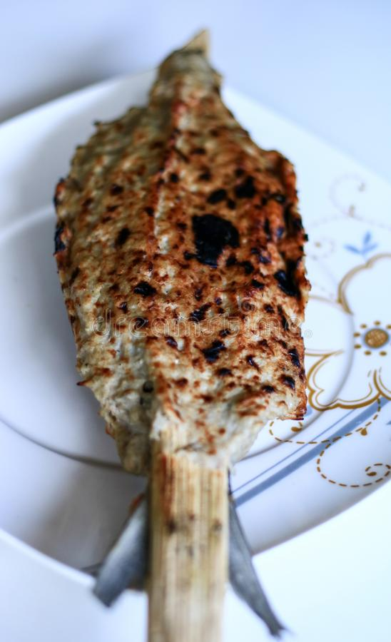 Milkfish Satay. Or Sate Bandeng on white plate. Traditional food from Banten, a province near Jakarta stock photos