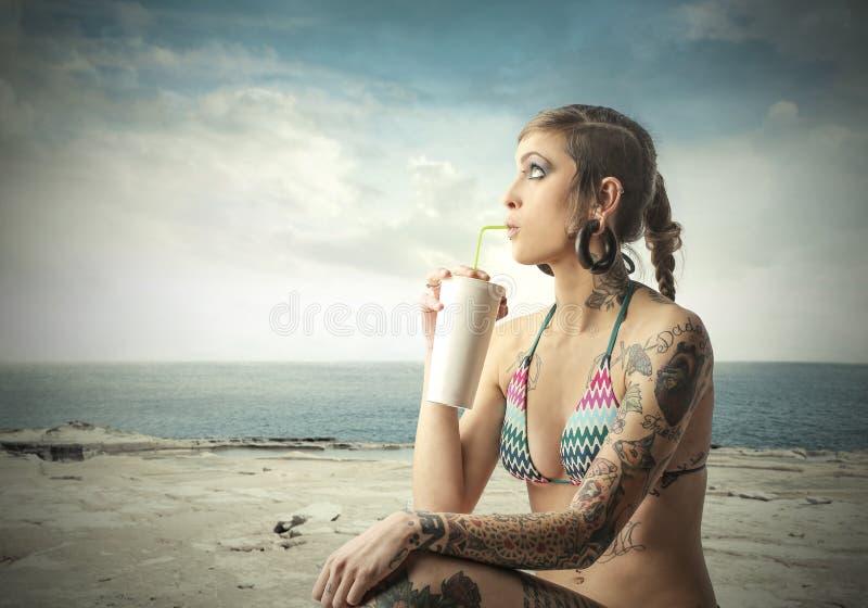 Milkshake on beach royalty free stock photography