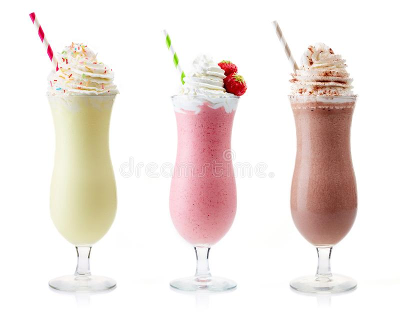Milkshake de vanille, de fraise et de chocolat photo stock
