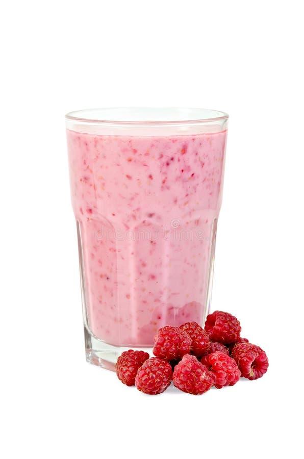 Milkshake with raspberries in a glass stock photo