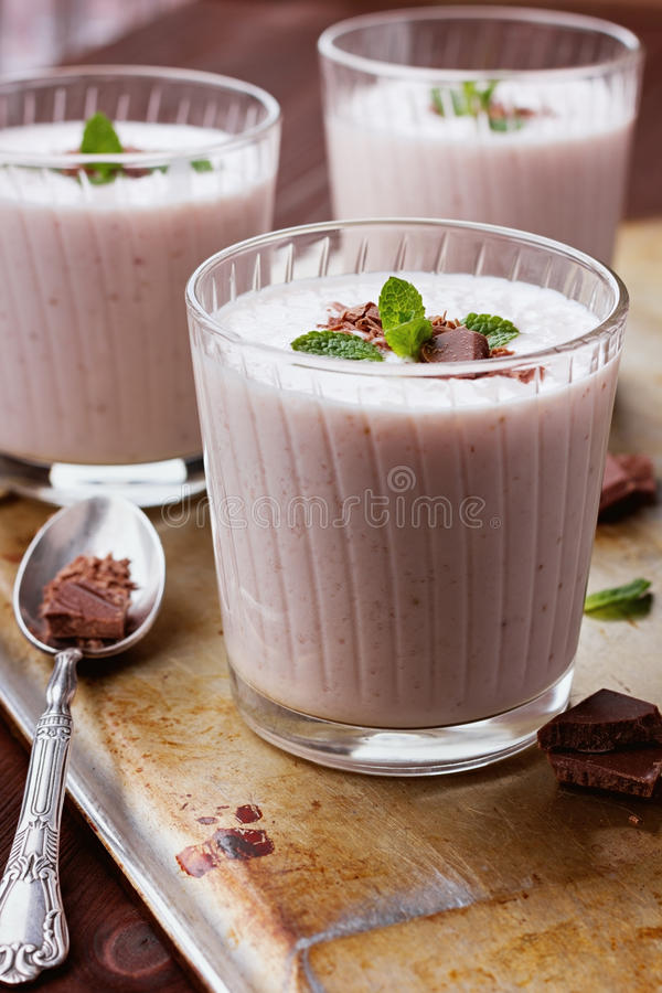 Milkshake with strawberry, chocolate and mint royalty free stock images