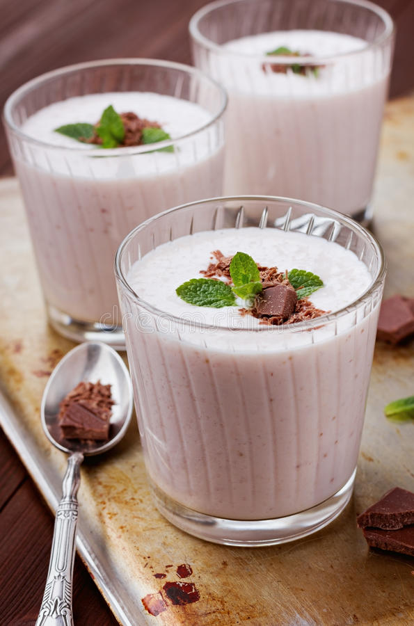 Milkshake with strawberry, chocolate and mint stock photography