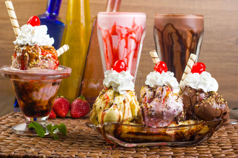 Milkshake, sundae and banana split. Party food. Milkshake, sundae and banana split stock photography
