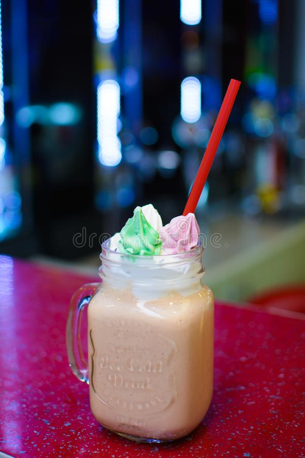 Milkshakes with black in the glass on the background bokeh.  royalty free stock photo