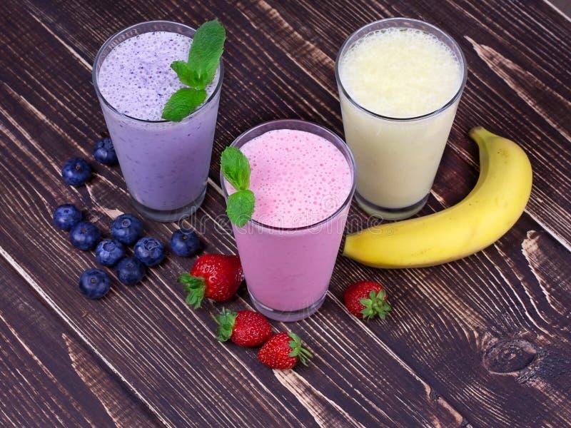 Milkshakes. Strawberry, banana and blueberries milkshakes stock photography