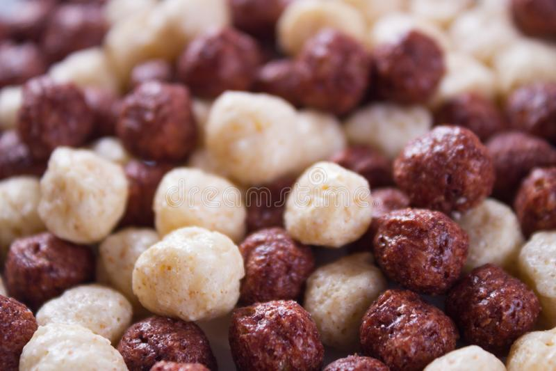 Milky and chocolate flakes. Sweet milky and chocolate flakes. background image stock photos