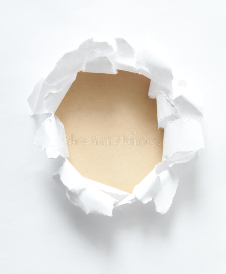 Milky circle shape breakthrough paper hole stock photo