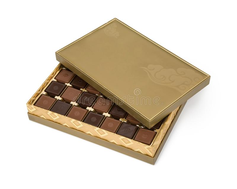 Milky and dark square chocolates in golden box, isolated stock images
