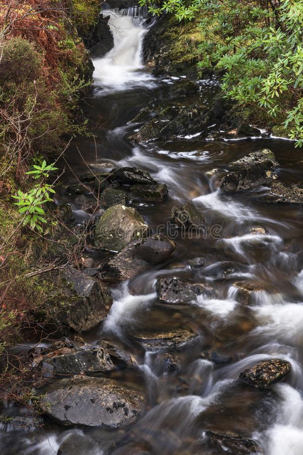 Milky Waters. Water flowing off the hills and down the burns in Moidart on the west coast of Scotland royalty free stock images