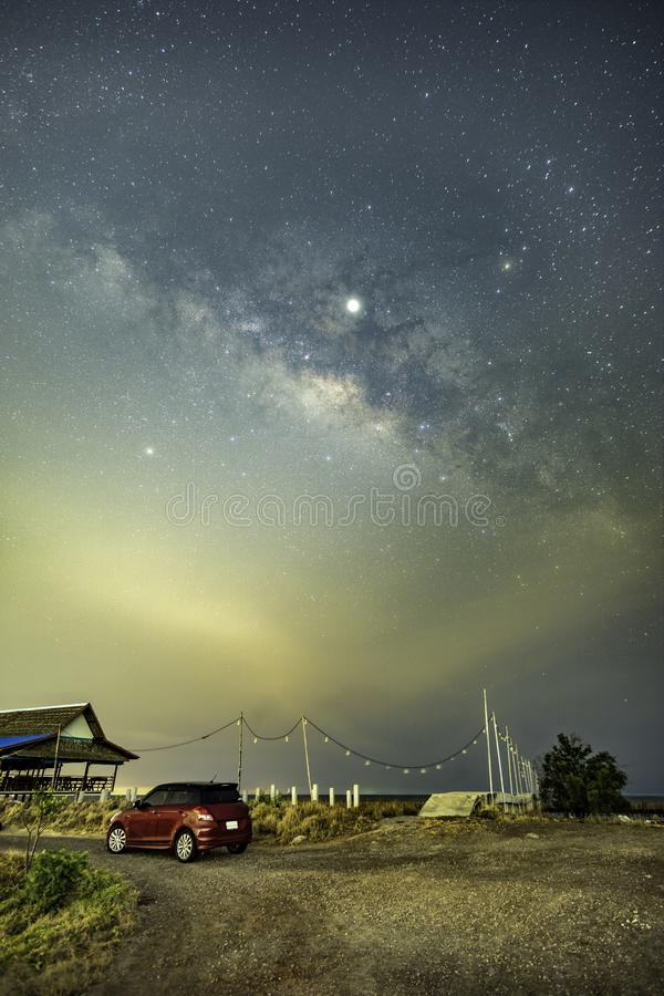 The Milky Way above the community outside the city. NThe Milky Way at the fishing port stock photo