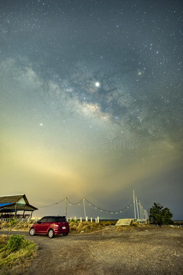 The Milky Way above the community outside the city. The Milky Way above the sea community outside the city in Thailand stock photos