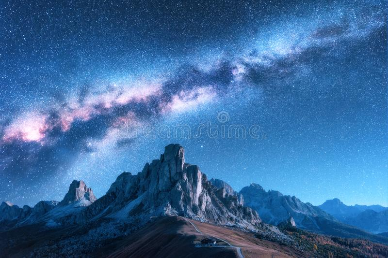 Milky Way above mountains at night in autumn in Dolomites, Italy stock image