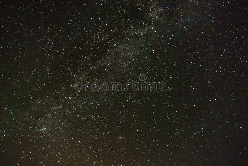 Milky Way on blue dark night sky as a cosmos background. Milky Way on blue dark night sky as a cosmos background stock photo