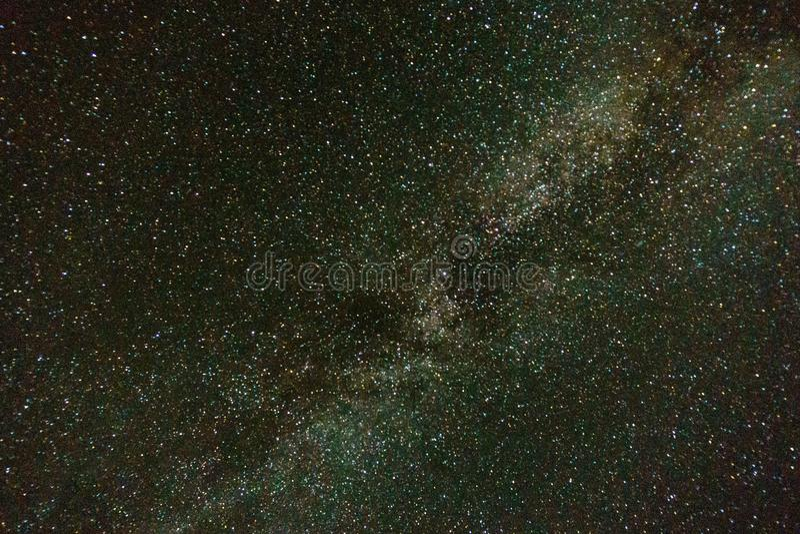 Milky Way on blue dark night sky as a cosmos background. Milky Way on blue dark night sky as a cosmos background stock image