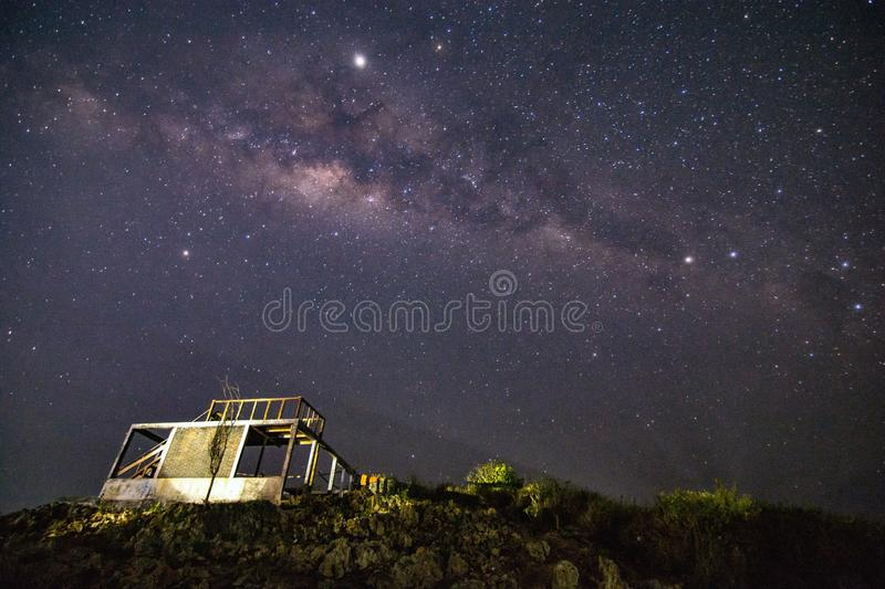Milky way with building and grass stock photo