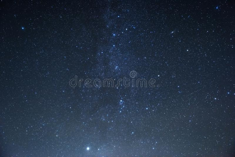 Milky way at center. Photo of beautiful blue night sky filled with stars royalty free stock images