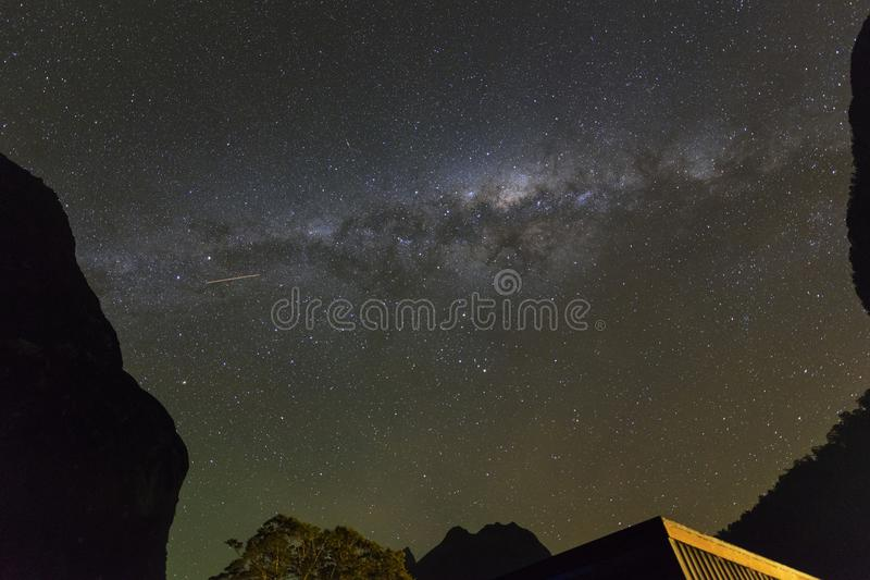Milky way on clear bight in Milford Sound, New Zealand. Milky Way at Milford Sound in South Island, New Zealand.Long exposure and high ISO photograph.with stock images