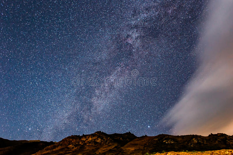 Milky Way with clouds in the mountains royalty free stock photography