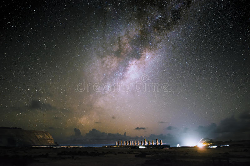 Milky way on Easter lsland and Moai at night, Chile. Moai at Ahu Tongariki with night sky and milky way background , Easter Island, Chile royalty free stock photography