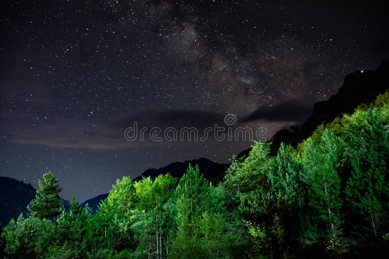 Milky Way with falling star above mountain peaks in National Park Valbona in Albania, Europe stock image