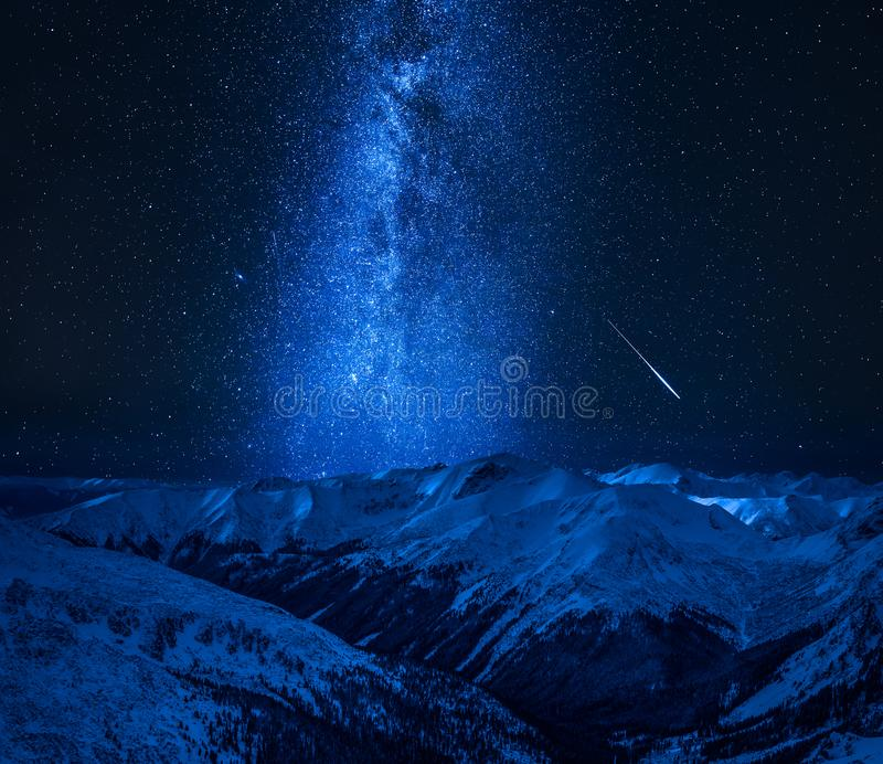 Milky way with falling star in Tatra Mountains, Poland stock images