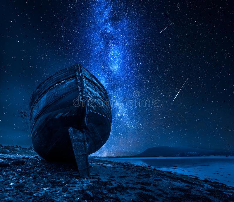 Milky way, falling stars and abandoned shipwreck, Fort William, Scotland. Europe royalty free stock photography