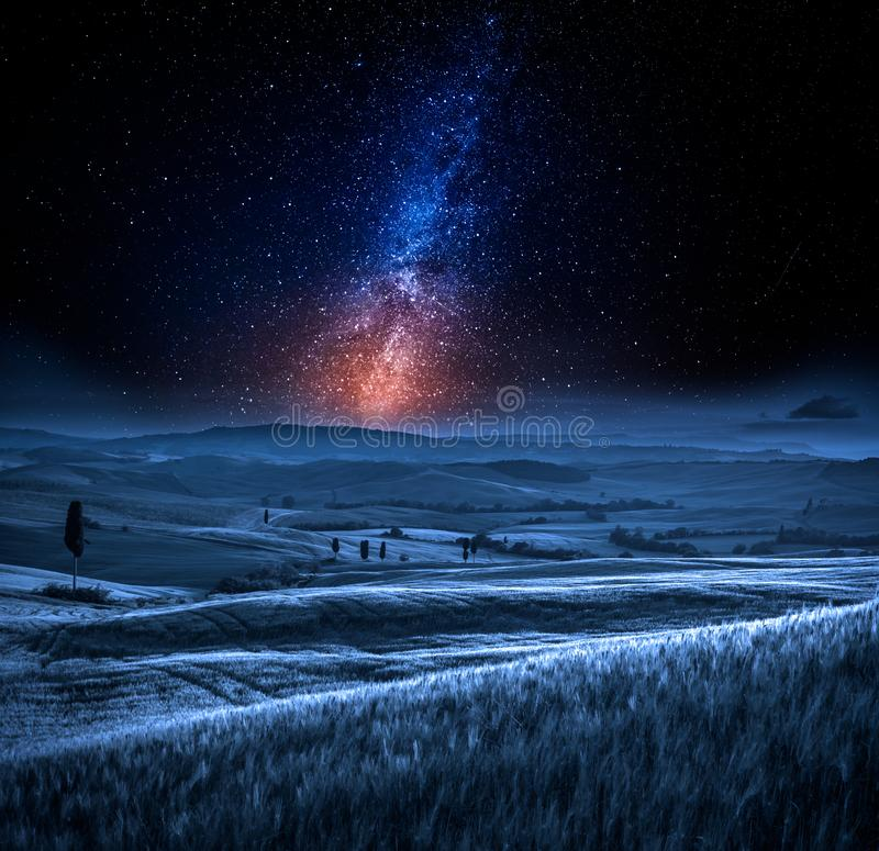 Milky way and field in Italy at night royalty free stock photo
