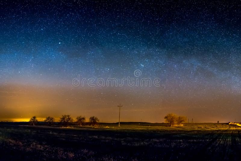 The Milky Way is the galaxy that contains our Solar System. The descriptive `milky` is derived from the appearance from Earth of the galaxy – a band of royalty free stock photography