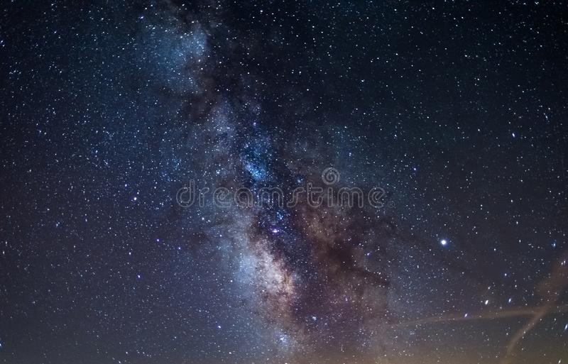 Milky way galaxy core and jupiter planet glowing in a bright starry night sky. Christmas background, astronomy, star gazing stock images