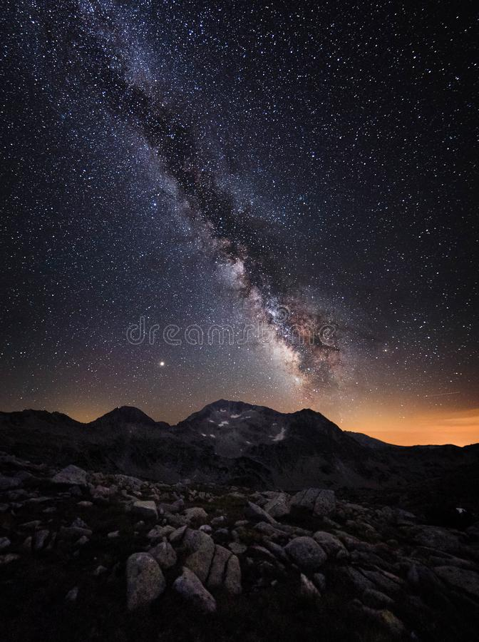 Milky Way galaxy and mountain peaks. Amazing scene of Pirin mountains and starry sky at night in Bulgaria. Rocks with peaks and sky with stars. Night landscape stock images