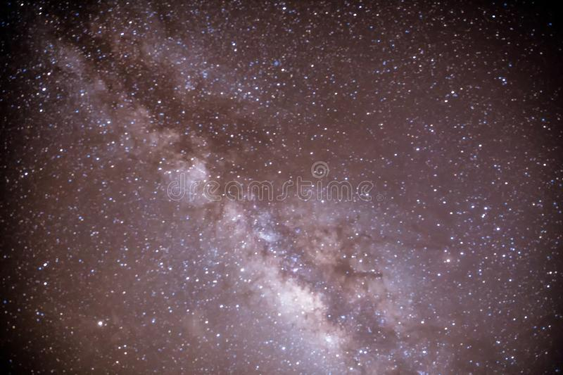 Milky way galaxy at night. Image contains noise and grain due to high ISO. Image also contains soft focus and blur. The Milky Way is our galaxy stock photography
