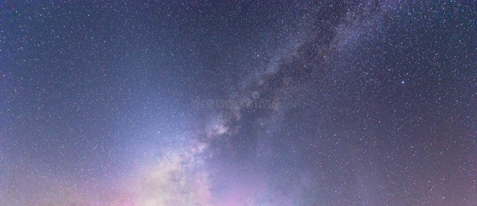 Milky way galaxy with stars at night sky and universe space background. Astronomy of twinkling stars and planets royalty free stock images