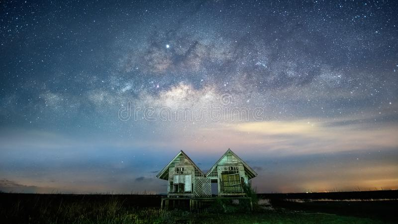 Milky way Galaxy with Twin houses at Pakpra village, Phatthalung Province. Thailand royalty free stock images