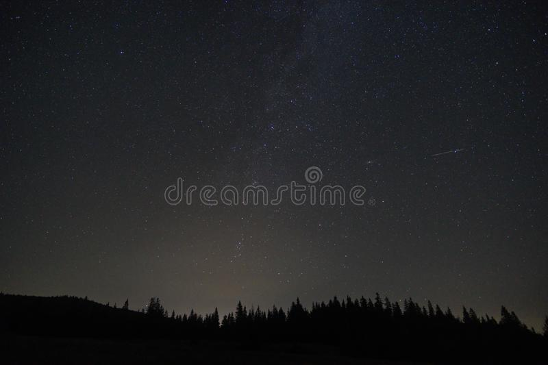 Milky Way landscape. Beautiful landscape of Milky Way in mountains in Harghita county, Romania. Raw file royalty free stock photo