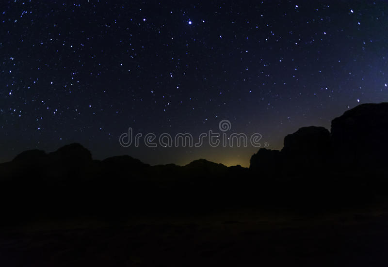 Milky Way and a lot of stars over the mountain at Wadi Rum desert royalty free stock image