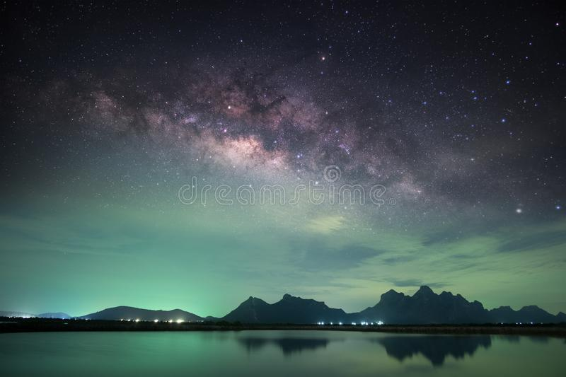 Milky way with mountain range. Clearly Milky way raised over mountain range reflects on lake stock photos