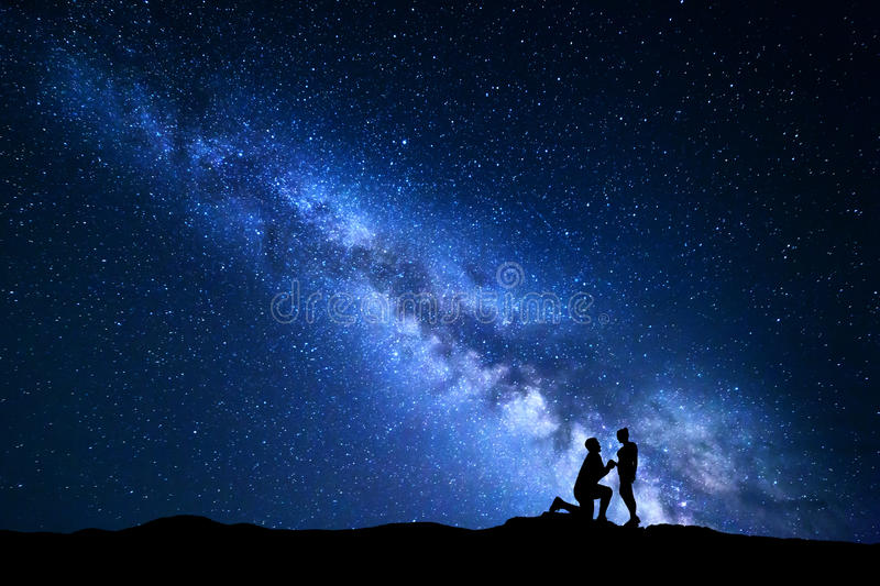 Milky Way. Night landscape with silhouettes of a couple royalty free stock photography