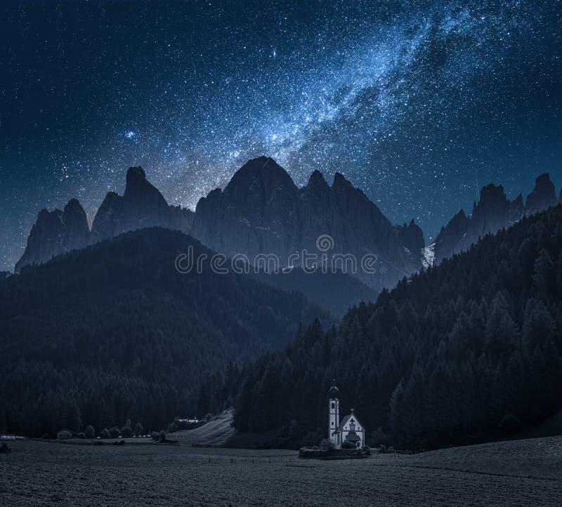 Milky way over Church St. Johann in Ranui, Dolomites. Europe royalty free stock photo