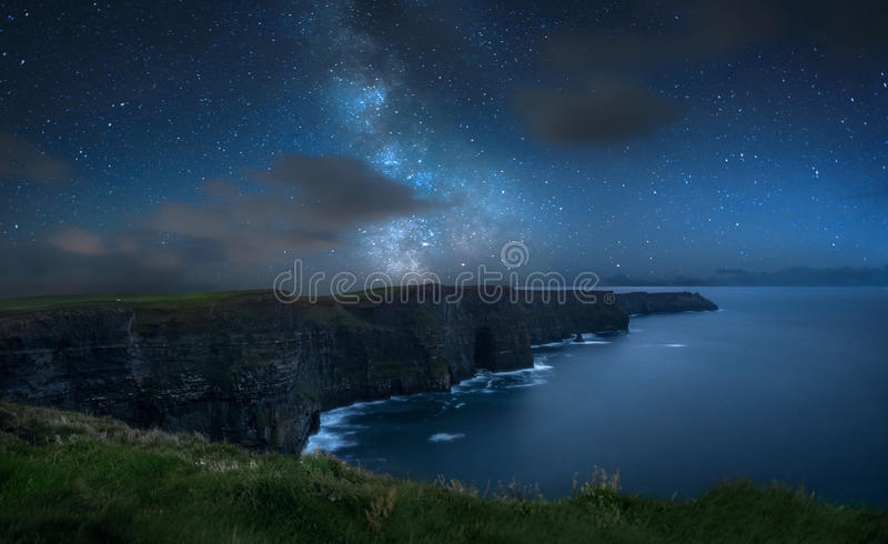 Milky way over Cliffs of Moher royalty free stock image