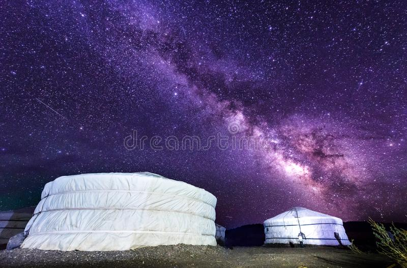 Milky way over ger camp in Mongolia gobi desert. Millions of stars in the sky at night in Mongol desert at a ger tent camp. Beautiful night sky with stars and stock image
