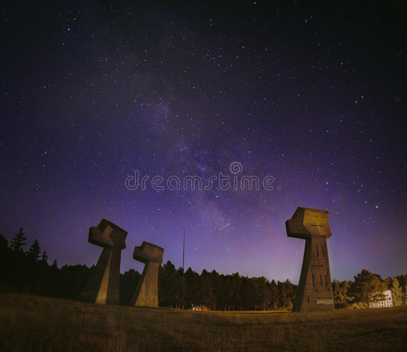 Milky way over a memorial park. `Bubanj` memorial park, built in 1963, is dedicated to the tens of thousands of Serbian, Jewish and Roma victims from the near by royalty free stock photos