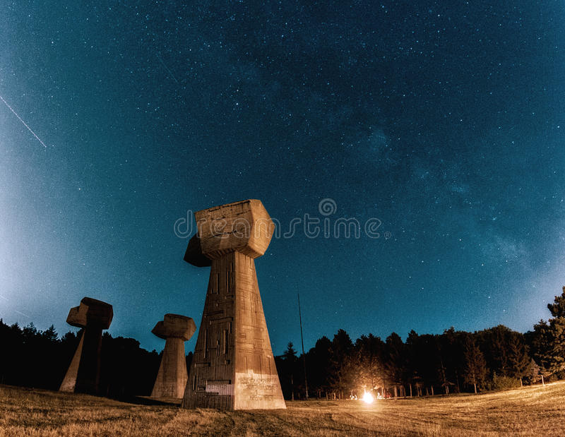 Milky way over a memorial park. `Bubanj` memorial park, built in 1963, is dedicated to the tens of thousands of Serbian, Jewish and Roma victims from the near by stock images