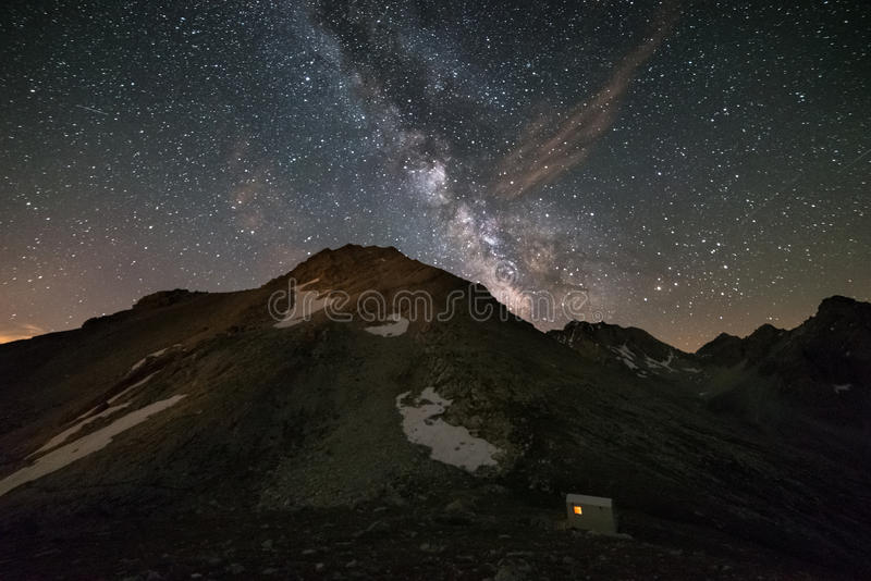 The Milky Way. Over the mountains, long exposure taken at 2500 m in the italian-french Alps. High iso: digital noise, grainy stock photography