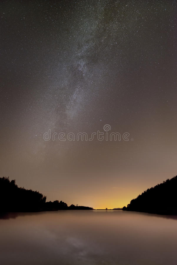 Milky Way. The Milky Way over Ridgegate Reservoir at Macclesfield Forest in East Cheshire, United Kingdom. The area suffers from a lot of light pollution, but stock photo