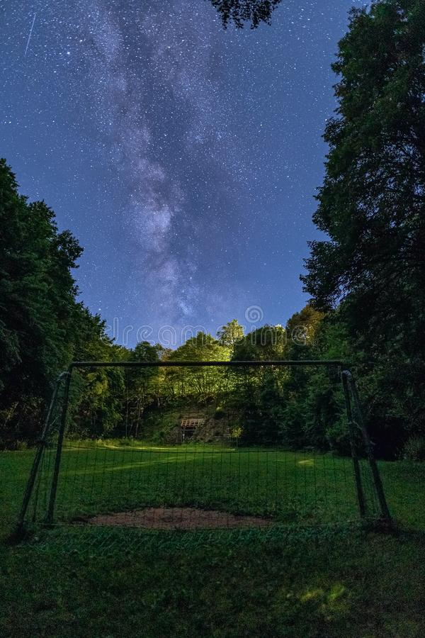 The Milky Way rises over a goal in the foreground. stock photography
