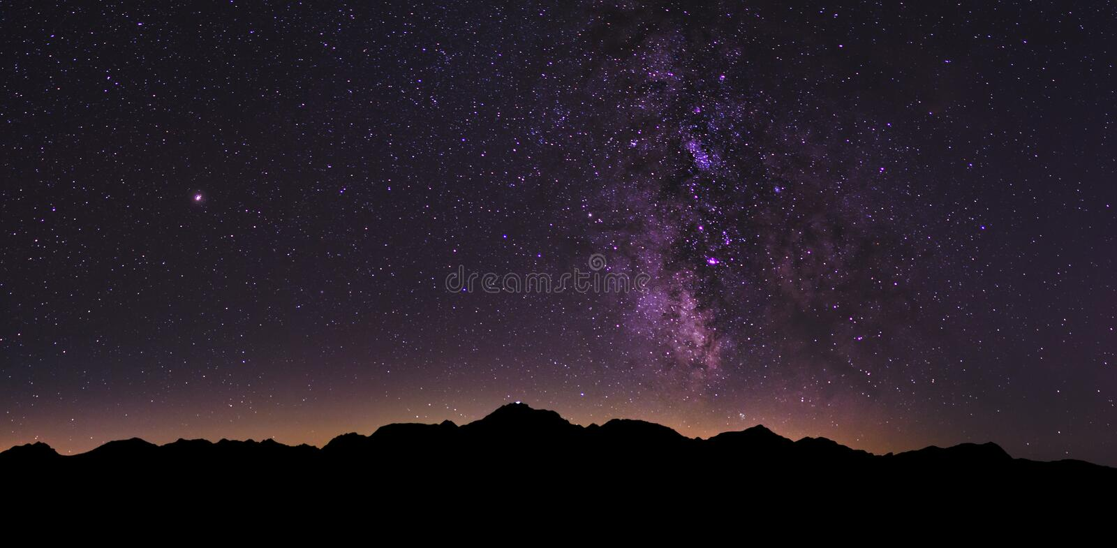 Milky Way Landscape in the Swiss Alps. The Milky Way rising over the Swiss Alps during a clear and dark summer night royalty free stock photography