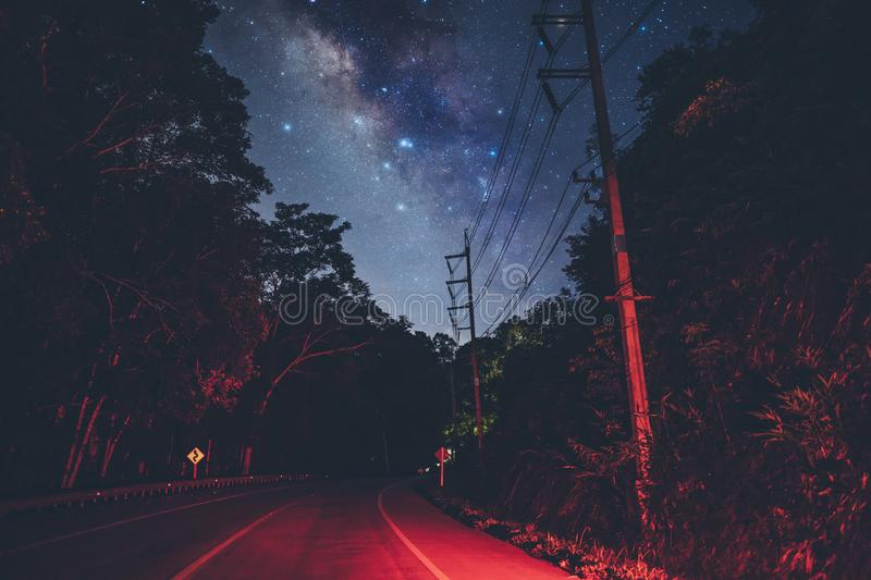 Milky way With the road And red lights stock image