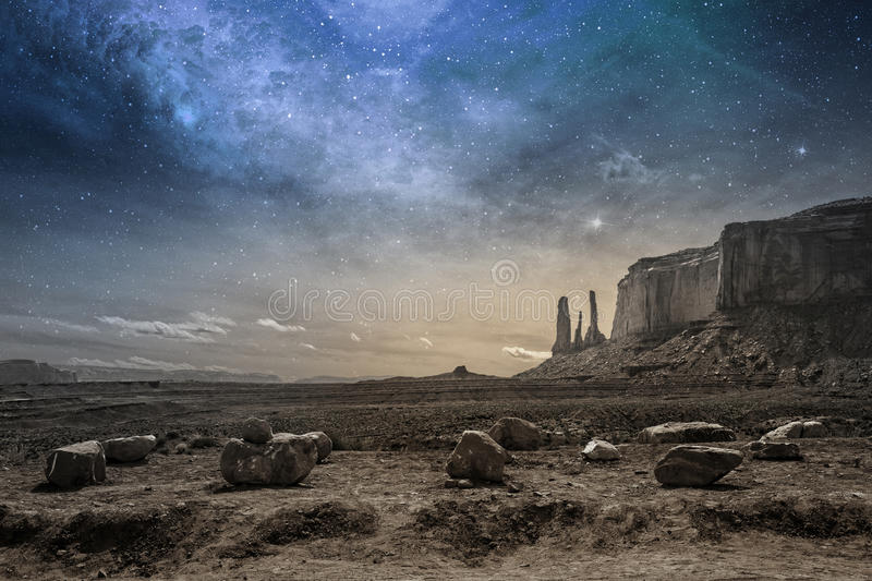 Milky way in a rocky desert landscape. View of a rocky desert landscape at dusk stock photos